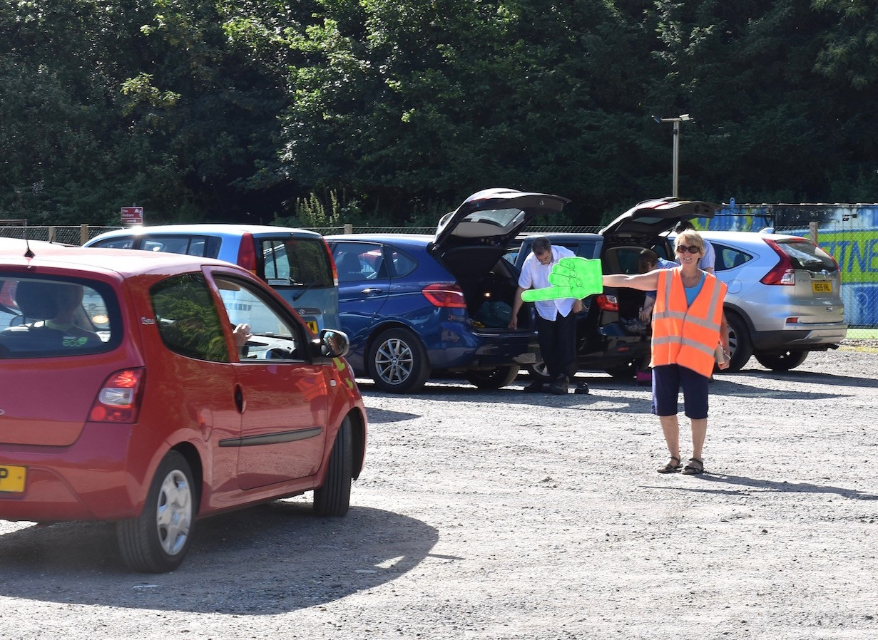 Steward helping with parking at rugby club